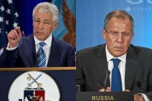 El secretario de defensa de EEUU Chuck Hagel y el ministro de exteriores ruso, Sergei Lavrov.